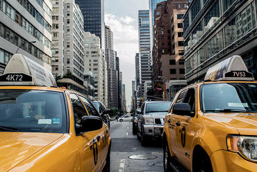 Two taxis in New York traffic
