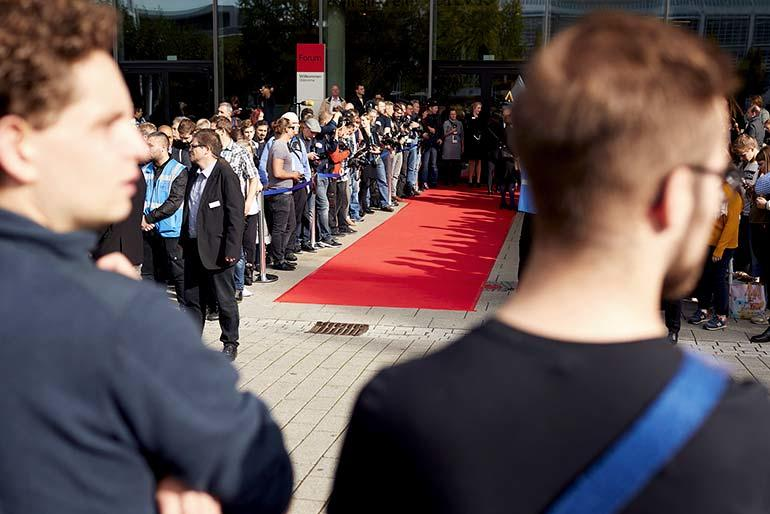 People are waiting at the red carpet