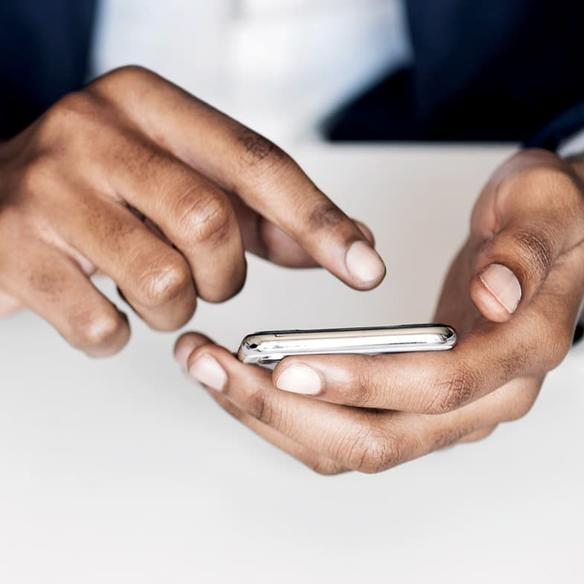 Closeup of hands with mobile phone