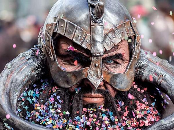 A man in a Viking costume full of confetti