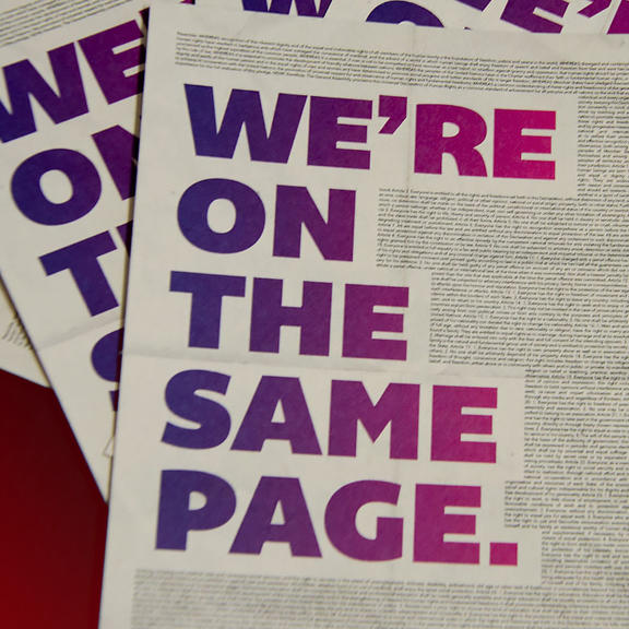 "Flyer für die Menschenrechtskampagne ""we are on the same page"""